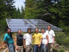 A group of RESU students pose in front of a newly installed photovoltaic array