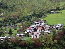 A distant view of the small rural village of Rukubji, Bhutan and the surrounding hills and fields